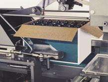 Tab slitter / top sealer for tablock cases provides high speed, in-line operation