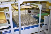 Bulk depalletizer for reverse taper wine and spirits bottles