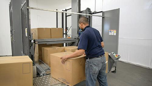 semi-automatic-palletizer-helps-packager-reduce-liability