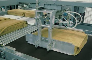 Automatically position product for high speed palletizing with overhead product orienter